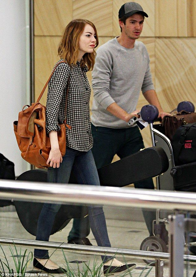 Just landed: Emma Stone and Andrew Garfield arrived at Sydney Airport on Sunday ahead of a brief promotional tour for their upcoming film Th...