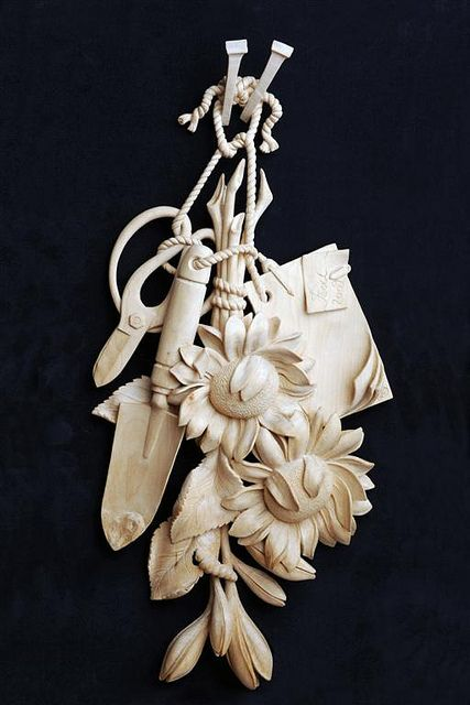 Grinling Gibbons Style of Woodcarving by Patrick Damiaens.  This guy's work is fabulous, have a look at his boards!
