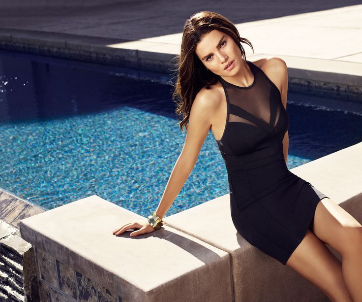Curves ahead. This gorgeous LBD features hot back straps, mesh inserts and a second skin fit