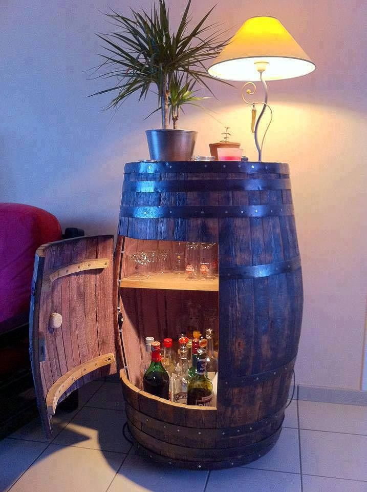 recycle an old wine barrel as a storage idea for bar or patio area find this pin and more on home
