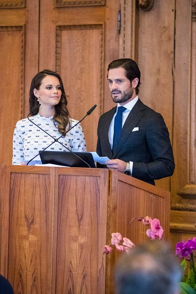 Princess Sofia of Sweden stood by her husband side Prince Carl Philip of Sweden, as he said a few words from the podium for their charity foundation at the Royal Palace in Stockholm