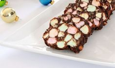 Chocolate Marshmallow Rolls...<3 I (coach bettylframe) have made these for years, for my  christmas goodie plate gift for  neighbors, my recipie is called stained glass windows and the roll is rolled in crushed grahm crackers and chilled in frigde to slice, yum