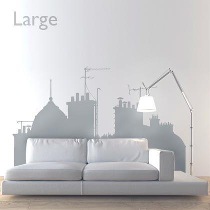 Créez une ambiance romantique dans votre pièce grâce à ce sticker mural représentant les célèbre toits parisiens.