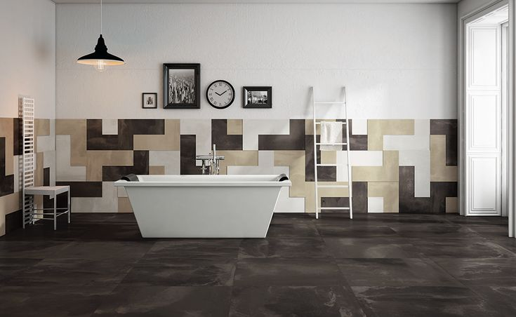 """The range of fine porcelain stoneware by Apavisa is complemented by the concrete-effect Nanoarea collection. The Tetris L-elements by Nanoarea are of particular interest. Simple but non-trivial, these elements cater infinite ideas of original layouts, for example, for the so-called """"tetris"""" arrangements."""