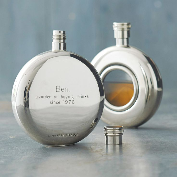 A truly sleek round personalised hip flask with a screw top. The round window hip flask features a highly polished finish and we can engrave the back for you.  This lovely personalised hip flask window hip flask has a glass front so you can see how much precious cargo you have left in your flask!  Supplied in a sleek black presentation box, this is an ideal personalised hip flask gift for your loved one, wedding party or special occasion.  The stylishly engraved hip flask is made from…