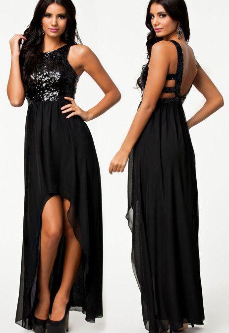 Aceasta este o rochie de seara lunga , superba, care dispune de un top din paiete stralucitor, care lasa spatele gol.