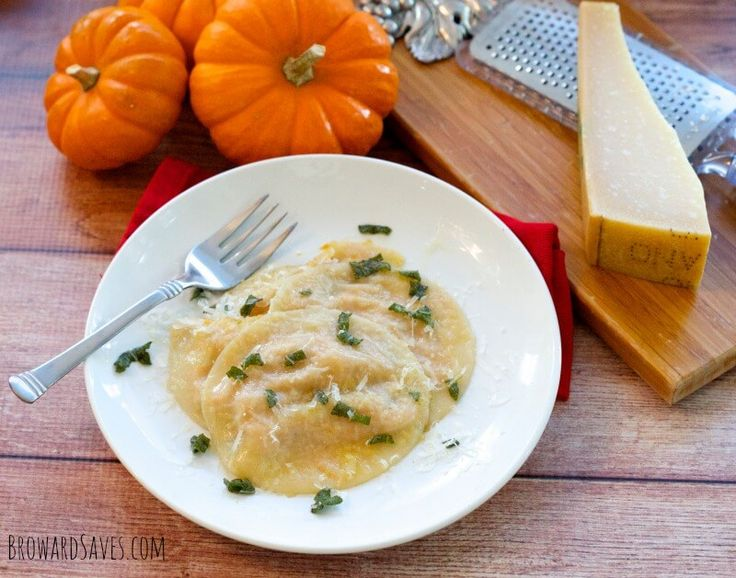Delicious Pumpkin Ravioli Recipe. Made a luscious pumpkin ricotta filling and served with a sage brown butter sauce. Top it off with parmesan cheese. Yum!
