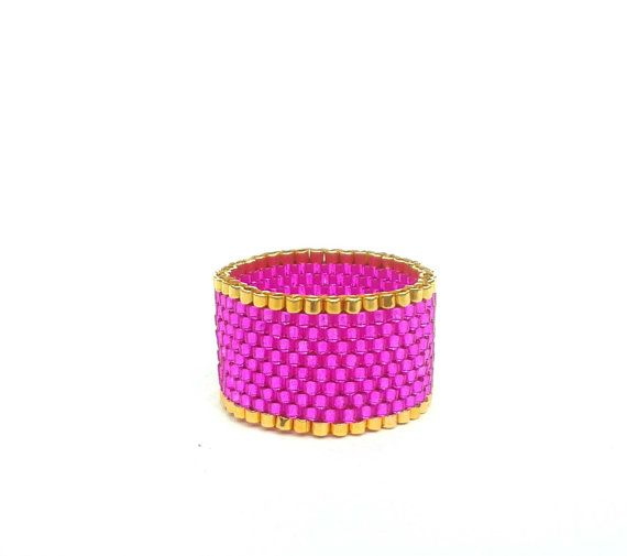 A sparkly metallic seed bead ring in hot pink.  This stunning ring has been made using professional quality glass seed beads. Each tiny, 2mm bead
