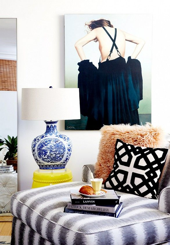 Fashion-inspired wall art and fluffy pillows