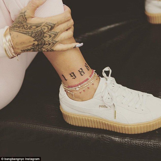 Special year: Rihanna has a new tattoo of the year she was born inked onto her ankle which...