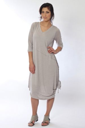 Modish, trendy and cut for dash. The Sophia linen knit dress, assymetrical and with a draw cord hem. Add the Planet sandal for the defining touch.
