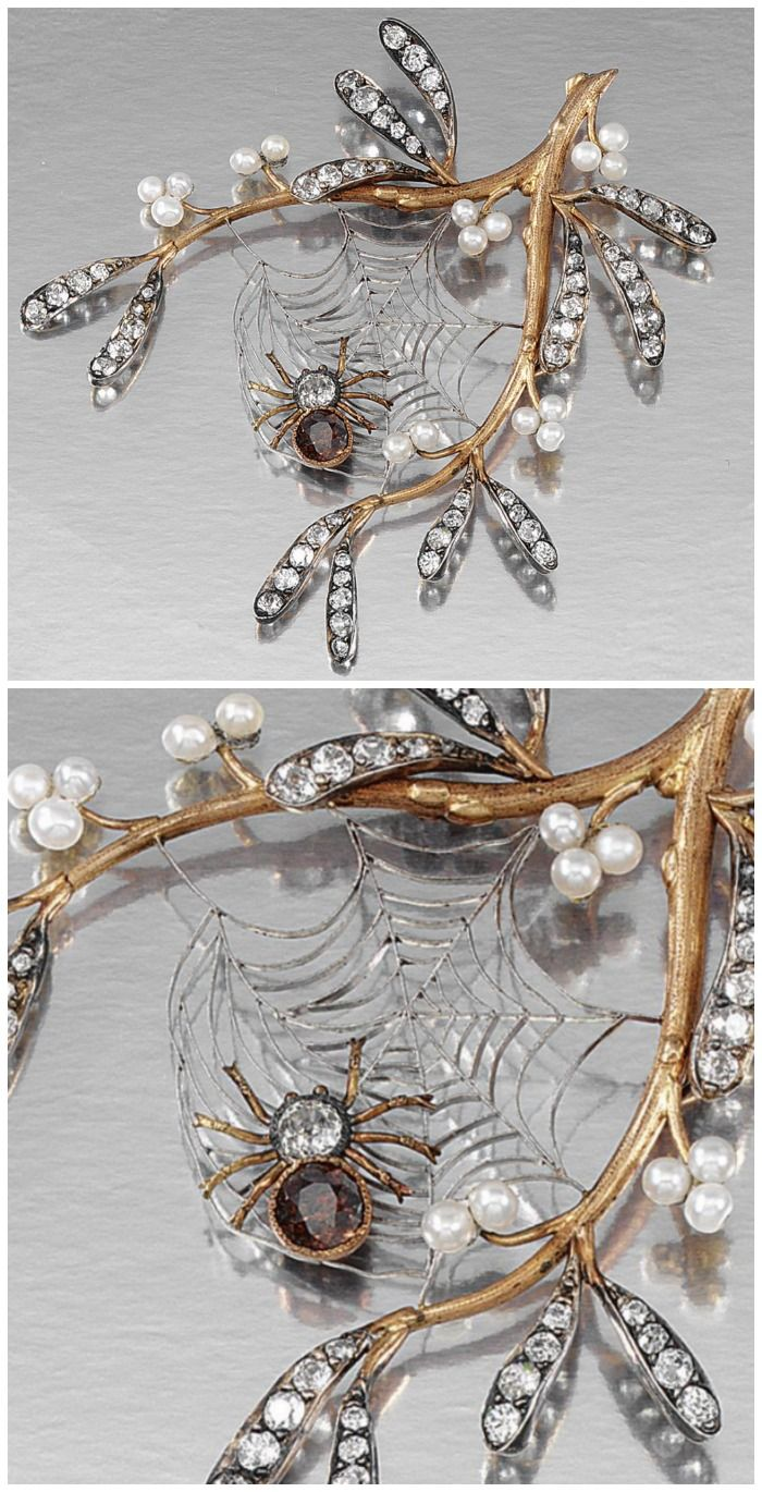 An antique Art Nouveau brooch featuring a diamond spider in its web on a gold, pearl, and diamond branch. Early 20th century.