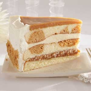Salted Carmel Cake.- A light, buttery vanilla cake, layered with caramel crunch and custard, then topped with more caramel.