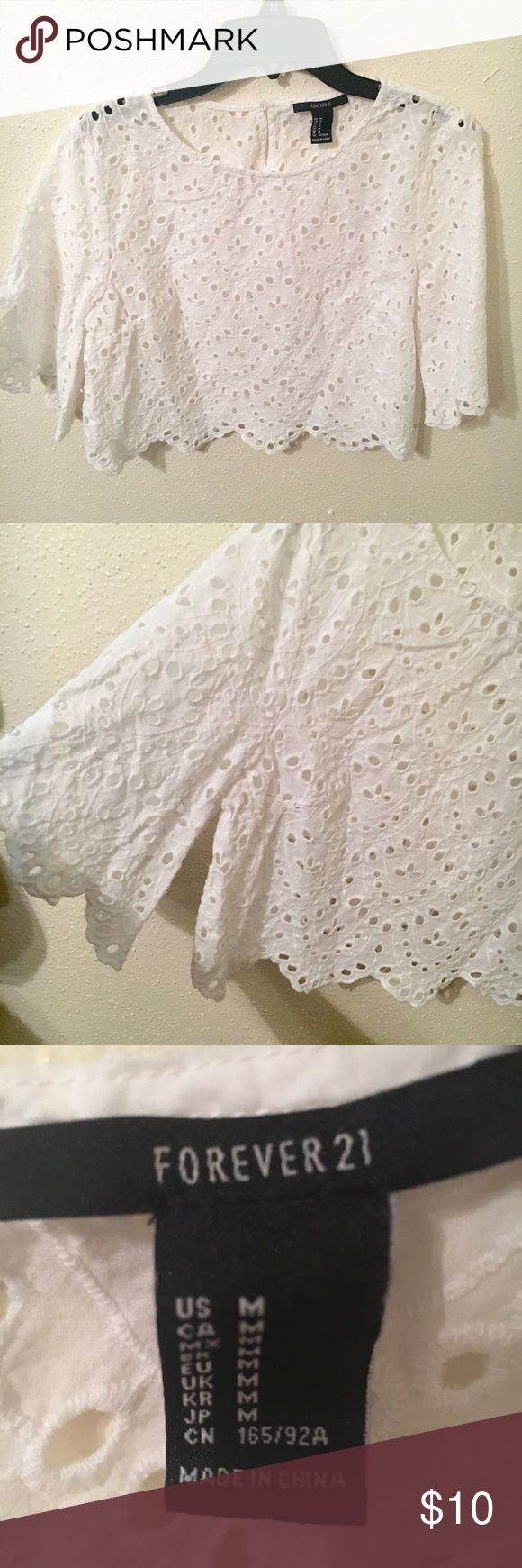 White Lace Crop Top This a super cute white crop top to wear with a colored skirt and some boots. Great college game day attire. Only worn 2 times, no stains! Forever 21 Tops Crop Tops