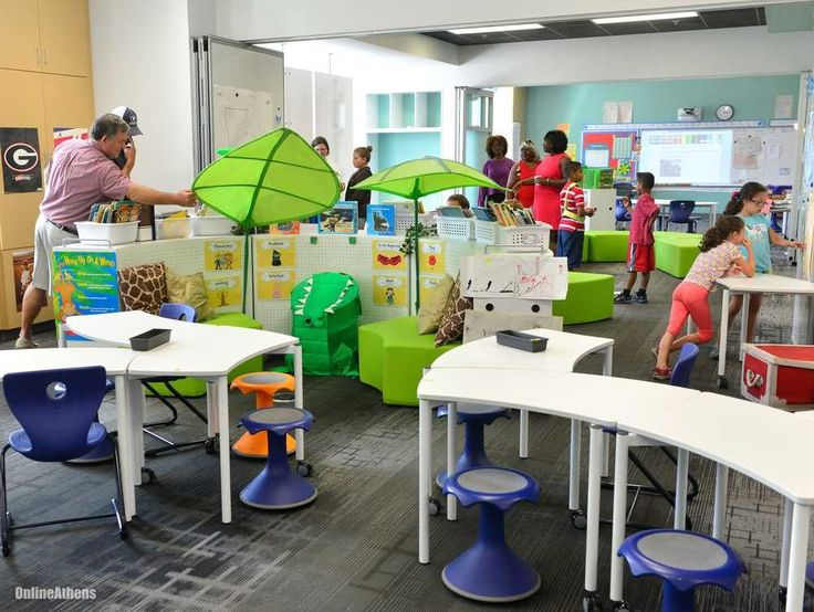 Barrow Elementary School's library in Athens, GA is one of the most amazing library makeovers I've seen.  All of the furniture (including the bookshelves) is mobile and flexible, allowing the space to constantly be changed up.