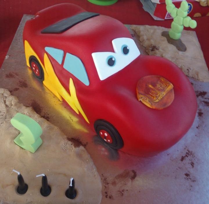 My Grandson Callums cake,he couldn't wait to cut it so he bit the back..Thanks to a migraine i didn't finish the front but he stilled luved it :)