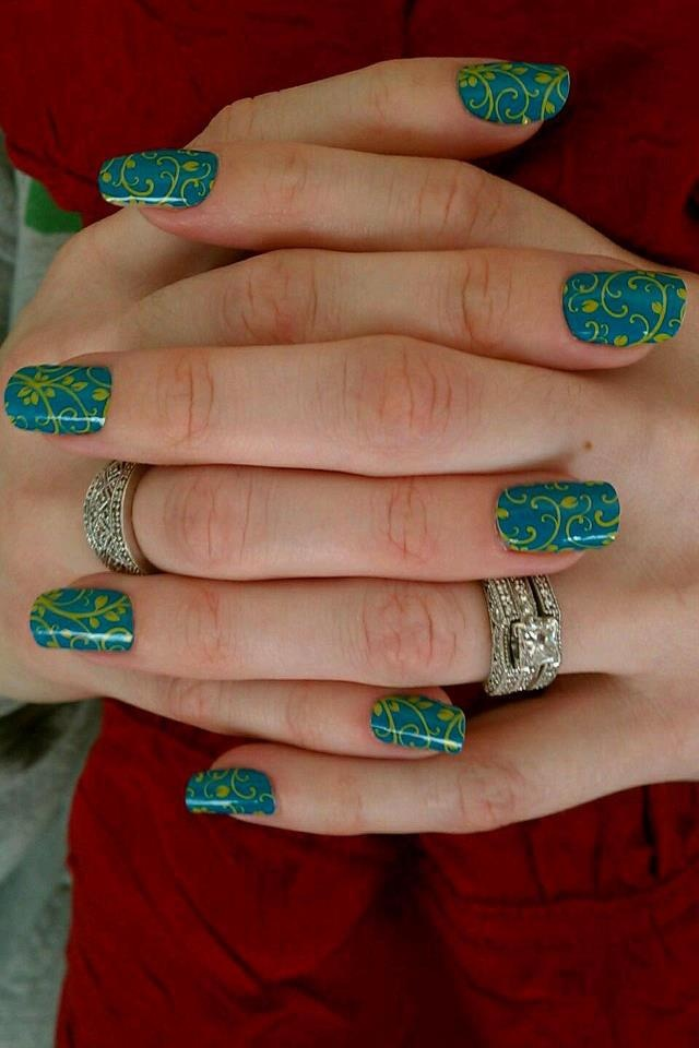 I wish I had long nails like this.  Did you know Jamberry Nails can be applied on artificial nails?  Although I still think they look best on short stubby nails like mine ;-)