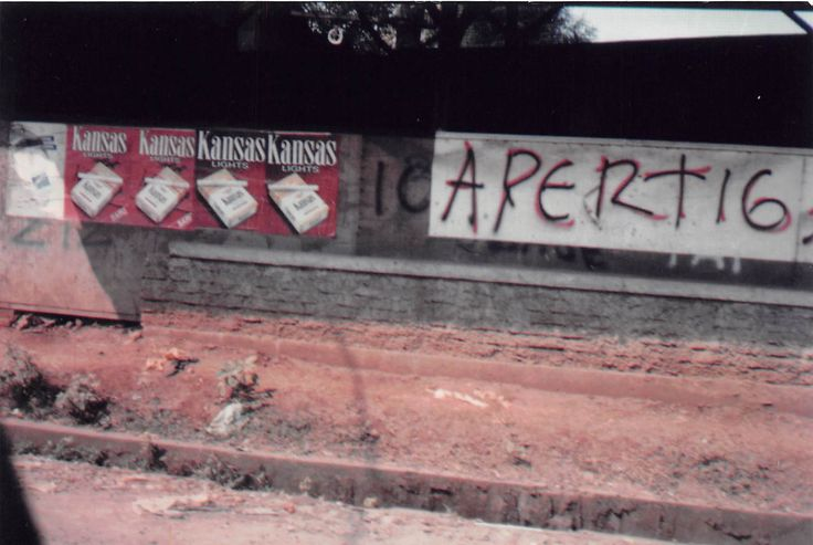 Kansas cigarette billboard - pasted to cement wall on busy streent, Jakarta