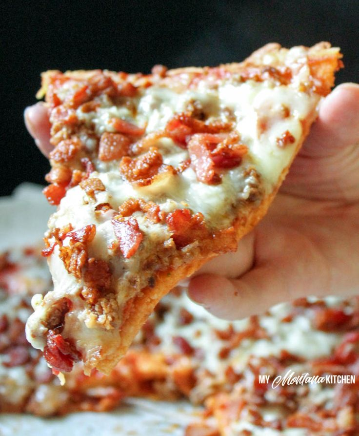 """A low carb pizza topped with three different meats, and with a crust sturdy enough that you can pick it up and eat it with your hands! This recipe is low carb, sugar free, and a Trim Healthy Mama """"S"""" fuel. (This post contains affiliate links, which provide me with a small compensation when you purchase your products through my links. Thank you for your support!) So, . . ....Continue Reading"""
