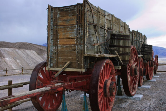 A covered wagon used to haul borax in Death Valley National Monument. (California & Nevada)