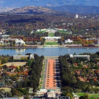 Australian War Memorial in foreground, across Lake Burley Griffin is Musuem of Australian Democracy (old Parliament House) then Australian Parliament House.