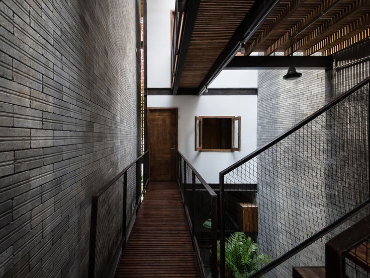 Gallery of Zen House / H.A - 19 House of Zen - railguard made from #metalmesh filter light to the narrow space, and add a touch of industrial charm #metalrailguard
