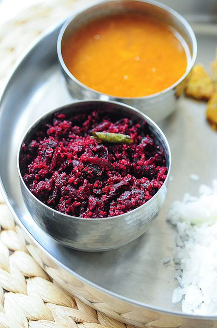 Thoran: Kerala condiment of coconut, finely chopped vegetable e.g. beetroot, cabbage or banana blossom fried with chilli, curry leaves and turmeric.