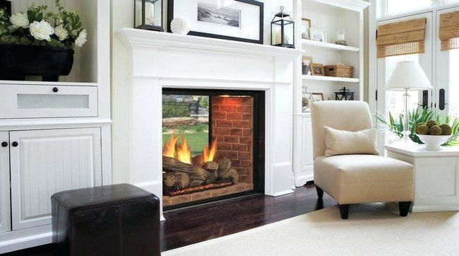 double sided electric fireplaces white themed living room upholstered chair this double sided fireplace creates the perfect double sided electric fireplace toronto