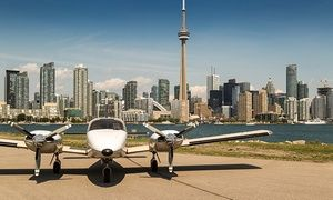 Groupon - C$ 149 for a 100km Aerial Tour of Toronto for Two with Champagne at Greater Toronto Airways (C$350 Value) in Billy Bishop Airport - Executive FBO Terminal. Groupon deal price: C$149