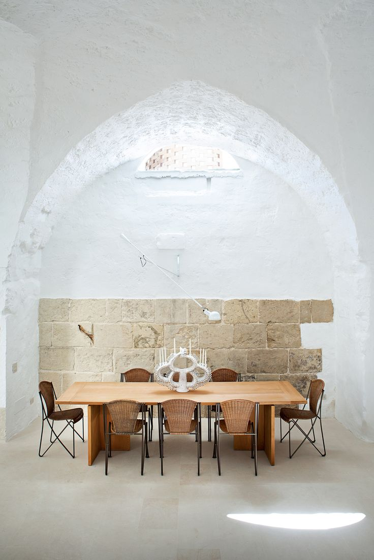 The acclaimed Italian designers Ludovica+Roberto Palomba carve a serene retreat out of a 17th-century oil mill in Salento, filling it with custom creations and their greatest hits.