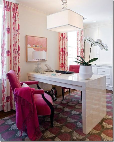 Floating office table in the middle with book shelves for storage on opposite wall.  Hang quote photos on the same wall.