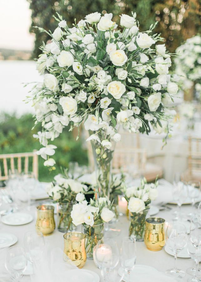 Rose and greenery wedding centerpiece: http://www.stylemepretty.com/destination-weddings/2017/02/28/a-greek-wedding-weekend-with-a-private-beach-spectacular-views/ Photography: Adrian Wood - http://www.adrianwoodphotography.com/