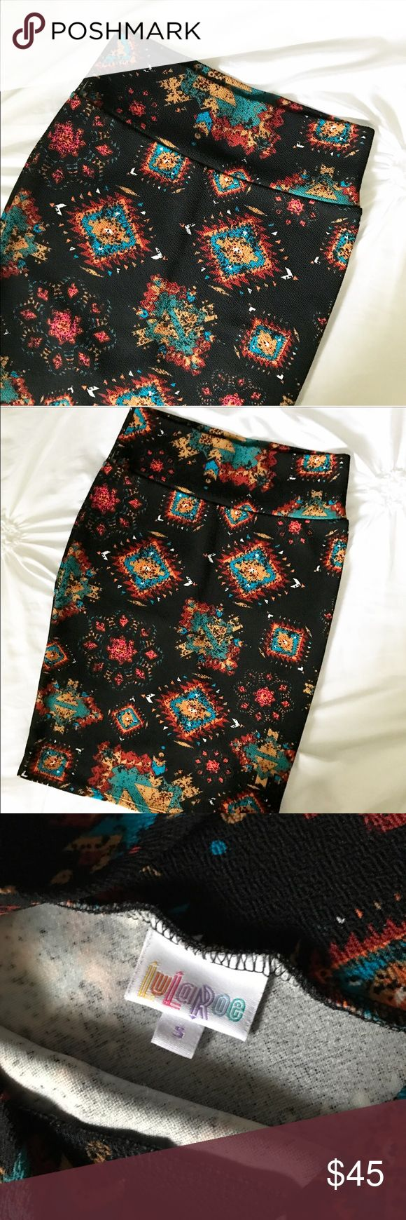 LuLaRoe  BLACK Aztec Print Cassie Skirt RARE Aztec print Cassie skirt with a BLACK background! This skirt is a gorgeous piece with lots of colors for mixing and matching!! In like new condition!!  LuLaRoe Skirts Pencil