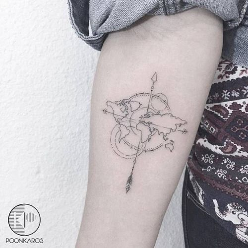 World map compass tattoo on the right inner forearm. Tattoo...