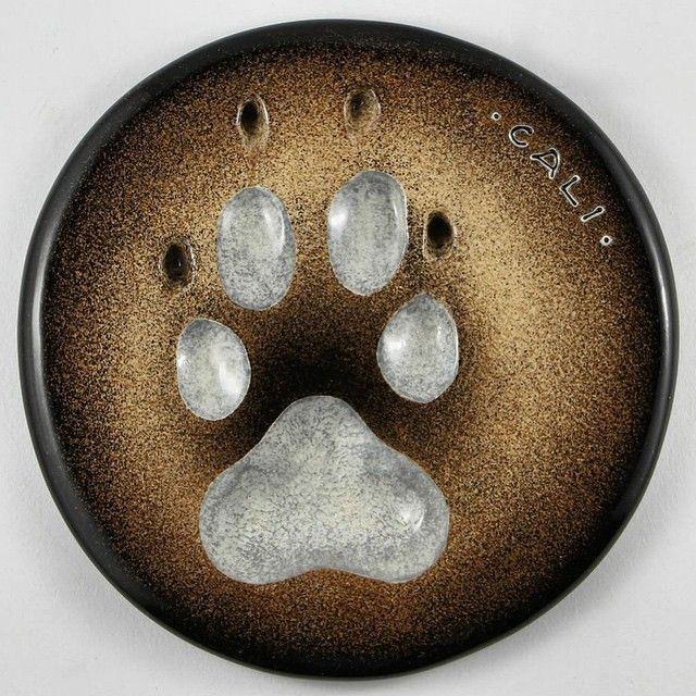 This ceramic impression for a dog named Cali has a light grey paw and the background color is matched to her fur. All our impressions are produced here in #yyc #PeartreePaws