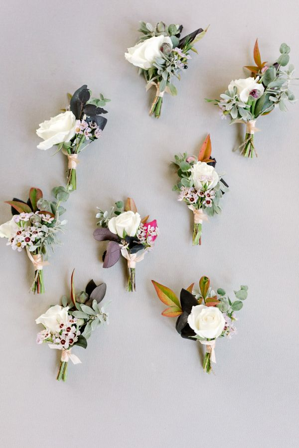 Rustic ivory rose and rustic berry boutonnieres: http://www.stylemepretty.com/texas-weddings/buda-texas/2016/12/19/rustic-elegant-texas-wedding-full-of-love/ Photography: Julie Wilhite - http://juliewilhite.com/
