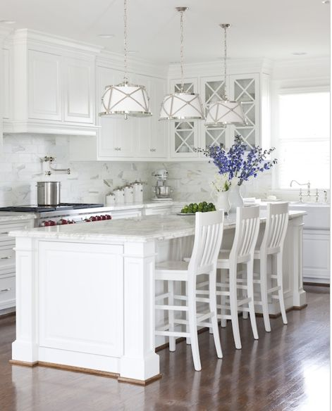 island stool spot, great idea for wood band to stop crumbs/scuffing?, criss-cross on cabinets, molding to ceiling, but way too white -- needs brown wood island