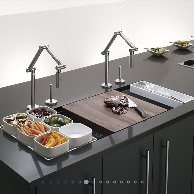 """I sink I love you"" ( Sorry – I'm German!) The sink is the hardest working area in the kitchen and is often put on the back burner when it comes to kitchen planning. Kohler's Stages sink was designed in collaboration with pro chefs and packs a ton of function. A sliding walnut cutting board and reversible trays expand the usable area of the sink when the large basin isn't needed. #candiceolson"