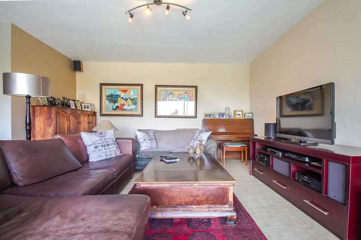 Living room to relax in, with large glass sliding doors that opens up onto the balcony. Fantastic views can be seen from here.