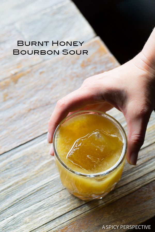 Burnt Honey Bourbon Sour - A twist on a classic Whiskey Sour with depth and intrigue! This summer cocktail is perfect for outdoor parties pairing well with