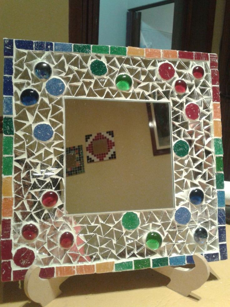 Picture frame with jewels and mirror pieces