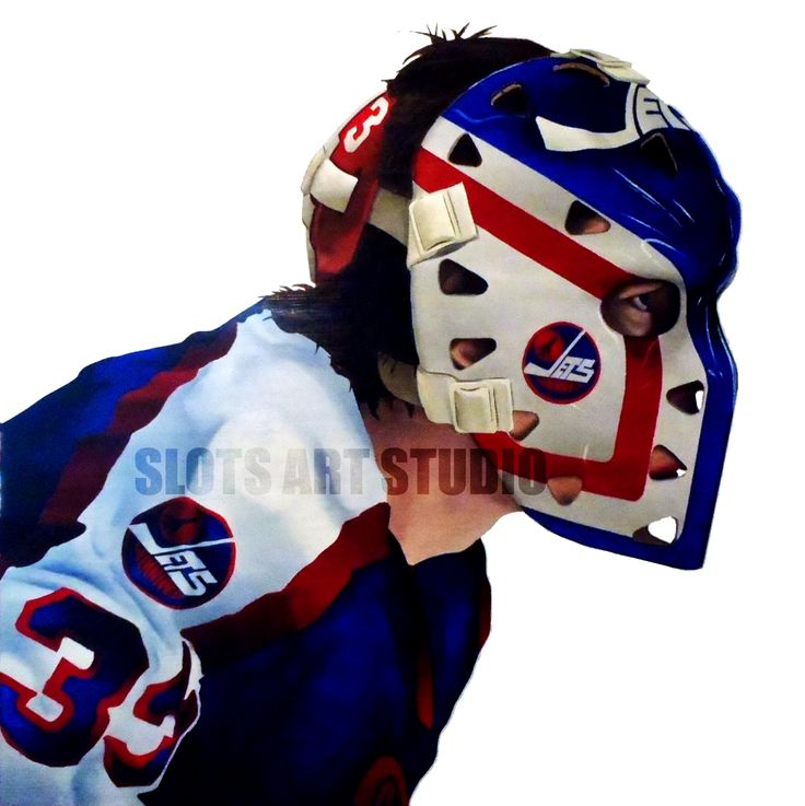 SOAPY, DOUG SOETAERT – Depicted as a Winnipeg Jets goaltender, Doug Soetaert is wearing a mask that may seem very familiar to New York Rangers fans. He played most of his career as a Ranger and kept the same mask design when he became a Jet's player since the team colours were both the same… The only difference is that he swapped out the logos. He has since refurbished his mask back to a Rangers logo in recent years.
