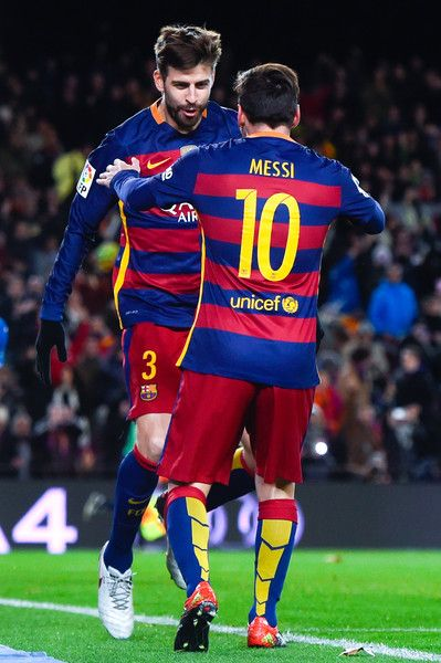 Gerard Pique of FC Barcelona celebrates with his teammate Lionel Messi of FC Barcelona after scoring his team's third goal during the Copa del Rey Round of 16 first leg match between FC Barcelona and RCD Espanyol at Camp Nou on January 6, 2016 in Barcelona, Catalonia.