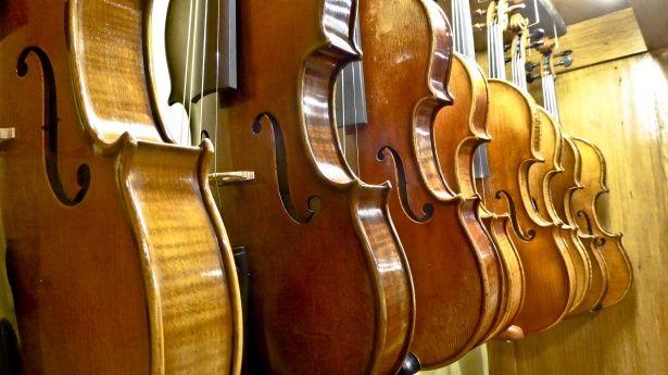 Row of cellos for sale at a violin restoration shop in Burlington, Vermont.