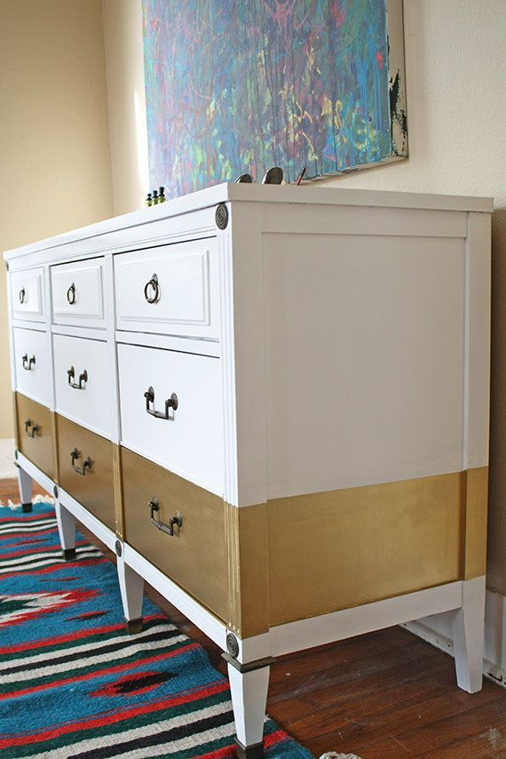 Saucy gold stripe gives a witty design statement to this otherwise plaint white upcycled sideboard.