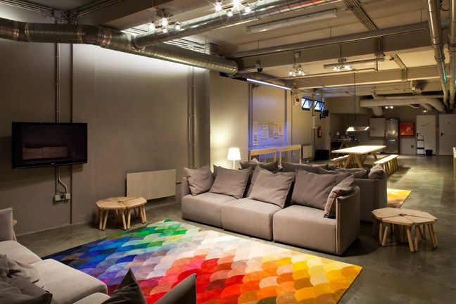 The Lisbonaire Apartments, available for holiday rental in Lisbon. The Basement lounge room, furniture by Pedrita Studio, Pixel rug by Piodão.
