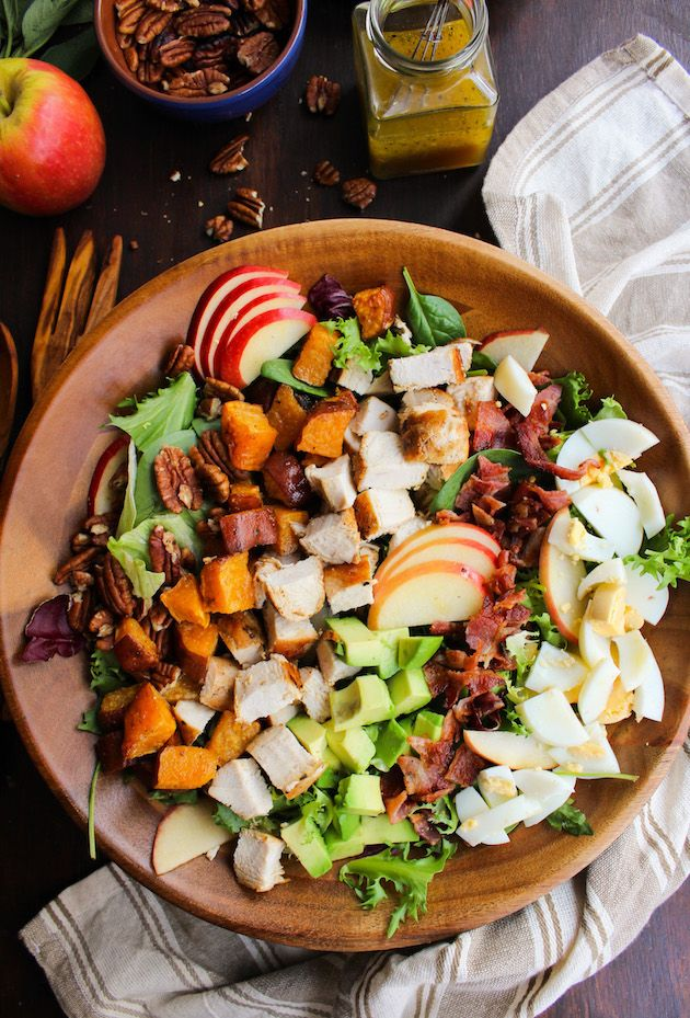 Loaded Autumn Cobb Salad | topped with honey crisp apples, roasted sweet potatoes, crumbled bits of bacon, chopped chicken and dressed in a tangy maple vinaigrette. Grain free   Paleo   Diary Free