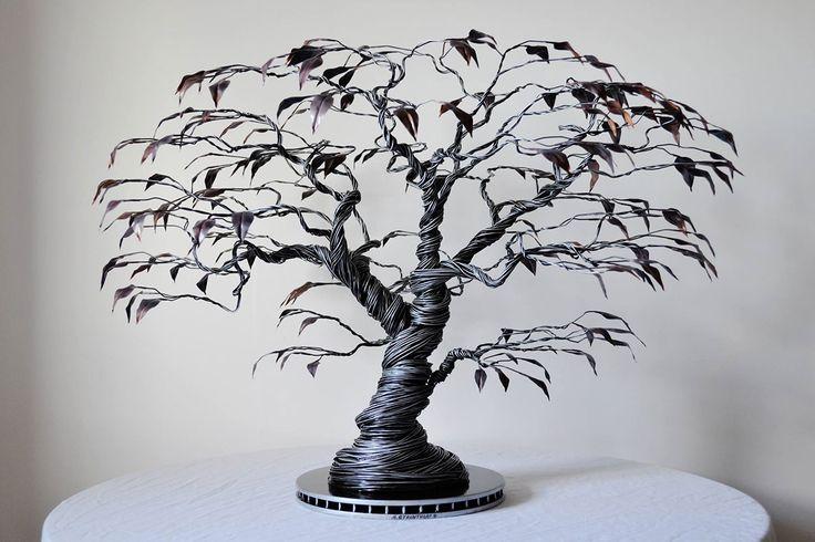 Cet artiste donne vie à d'élégantes créatures avec du simple fil de fer #sculpture #arbre