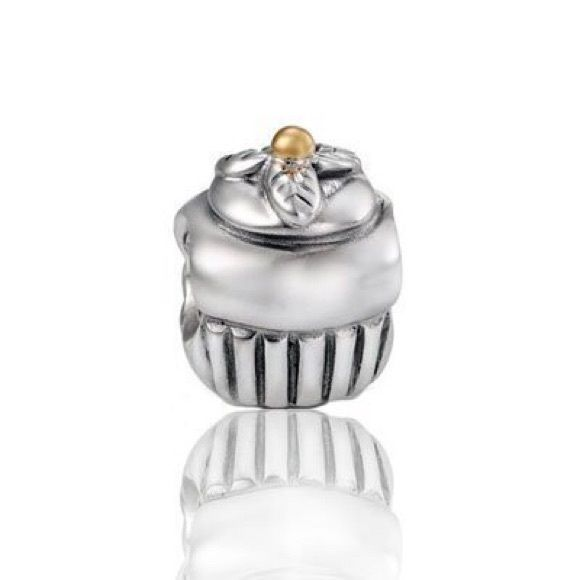 Pandora birthday cupcake charm This is a birthday charm. A cupcake with a golden cherry. Great condition Pandora Jewelry