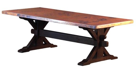 This beautiful copper table features a thick reclaimed wood trestle base.  This rustic copper table can be made any size.  The copper is also reclaimed.  Woodland Creek only carries the highest quality copper available.  It is thick, hand hammered, and torch fired by artisans that have been making copper tops for decades.  Some of our competitors